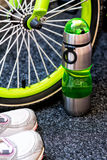 Bike weel, bottle and sport shoes Stock Photo