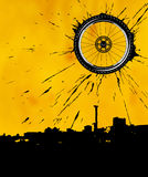 Bike wheel as the sun. Over the city Stock Image