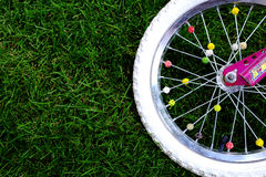 Bike Wheel on Grass Stock Photos