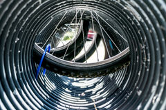 Bike wheel seen through bike stand. Stock Photo