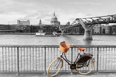 Bike with wicker basket against St Pauls backdrop, Stock Photography