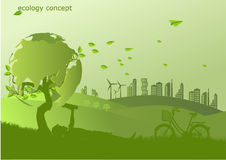 The bike ,windmill and solar panels on the grass  ,Environmentally friendly world Stock Image