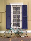 Bike and window. Bike leaning against window Stock Photography