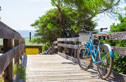 Bike on a wooden bridge on the road to the beach Stock Photography