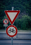 Bike and yield sign Stock Photo