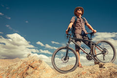 Bikeer traveler with bicycle portrait in Himalayas mountain Royalty Free Stock Image