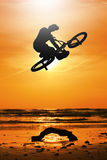 Biker. On a sunset background Royalty Free Stock Photography
