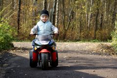 Biker. Young boy 6 years old driving toy motorbike Stock Images