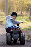 Biker. Young boy 6 years old driving toy motorbike Stock Photography