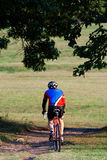 Biker. The man riding the bicycle Royalty Free Stock Image