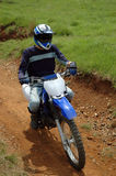 Biker. Bikes and Quads during an off road race royalty free stock photography