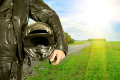 Biker. Motorcycle biker with helmet closeup on a road Stock Photography