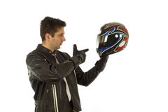 Biker. In black jacket holding a helmet Royalty Free Stock Photo