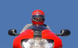 Biker. Man on a red bike royalty free stock photo