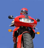 Biker. Man on a red bike royalty free stock photography