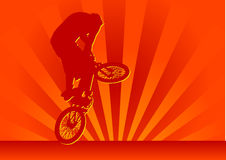 Biker. Abstract stunting biker in the setting sun Royalty Free Stock Photography
