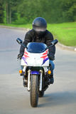 Biker. On sport bike in the movement Stock Photos