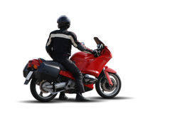 Biker. Man with Helmet Riding a Red Superbike stock photos