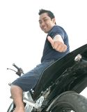 Biker. Man driving motor bike low angle Stock Photos