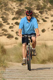 Biker in action Stock Images