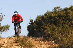 Biker in action. In a difficult road Stock Images