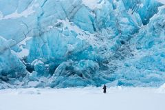Portage glacier in wintertime. Biker admire the awesome view of the  Portage glacier, Alaska, USA Stock Images