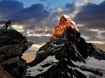 Biker in Alps royalty free stock photos
