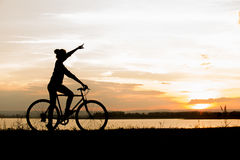 Biker-asian girl at the sunset Royalty Free Stock Photography