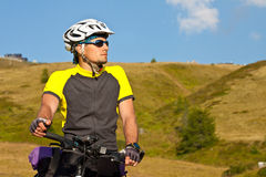 Biker beside a beautiful mountains Royalty Free Stock Images