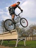Biker on bench royalty free stock image
