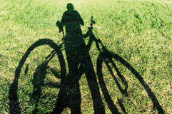 Biker and bicycle shadow Stock Photography