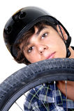 Biker with bike. Young,  biker with BMX and looking at camera. Isolated on white background Royalty Free Stock Images