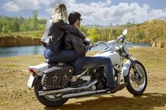 Biker blonde girl in black leather jacket royalty free stock photography
