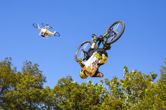 Biker blue sky jump drone Royalty Free Stock Photo