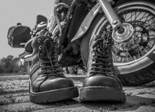 Free Biker Boots With Laces Close-up Standing Near The Wheel Of A Motorcycle Chopper Stock Photos - 182135933