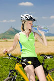 Biker with bottle of water, Stock Image