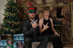 Biker Boy with Elf Hat and his Woman stock images