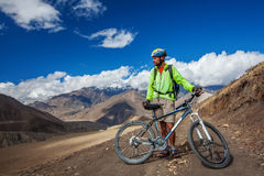 Biker-boy in Himalaya mountains Stock Photography