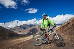 Biker-boy in Himalaya mountains Stock Photography