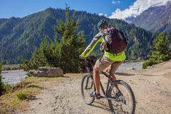 Biker-boy in Himalaya mountains Royalty Free Stock Images