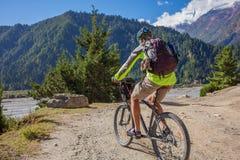Biker-boy in Himalaya mountains Royalty Free Stock Images