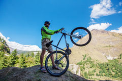 Biker-boy in Himalaya mountains Stock Photo