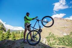 Biker-boy in Himalaya mountains Stock Photo