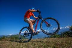 Biker-boy in Himalaya mountains Royalty Free Stock Photos