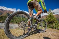 Biker-boy in Himalaya mountains Stock Image