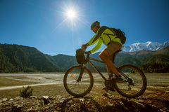 Biker-boy in Himalaya mountains Royalty Free Stock Image