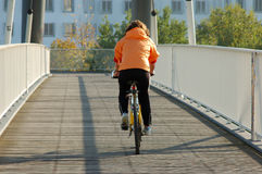 Biker on the bridge Stock Photography