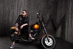 Biker caucasian man sitting on motorbike Royalty Free Stock Photo