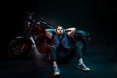 Biker caucasian man sitting near motorcycle motorbike Royalty Free Stock Images