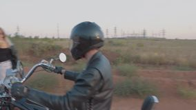Biker caught up with the hitchhiker. On the road stock video footage